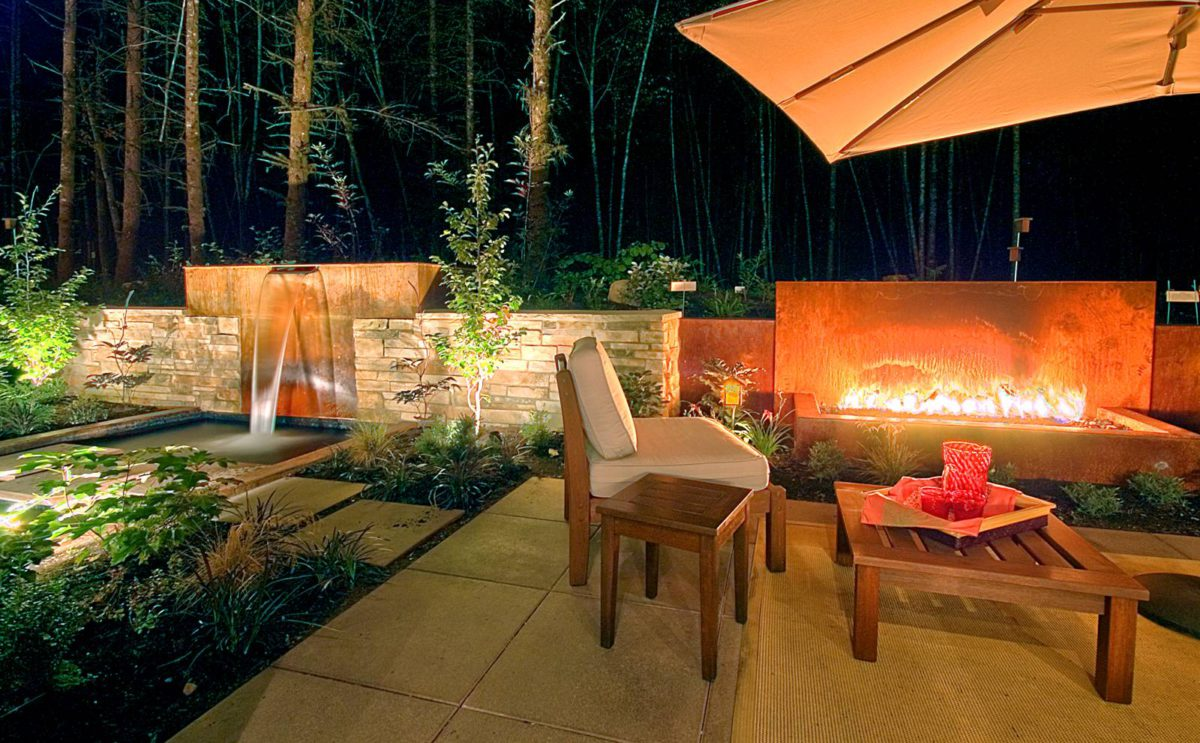 Pattern language. The fire pit adds drama to the landscape. Lighting adds an additional sense of warmth. In Harmony Sustainable Landscapes